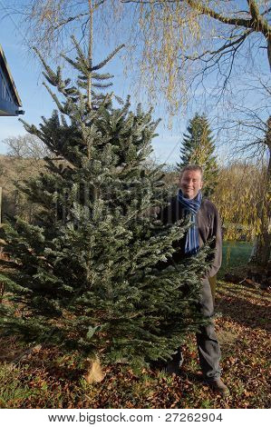 Man with his real Christmas Tree