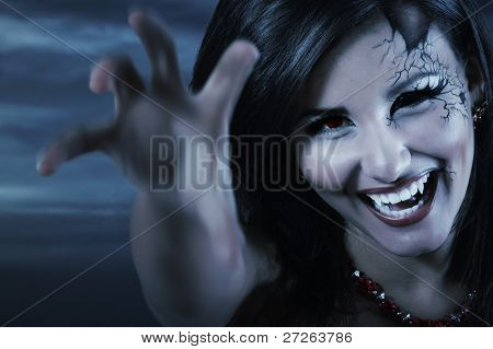 woman beautiful halloween evil vampire over night background