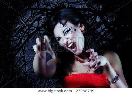 woman beautiful halloween vampire over night background