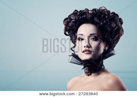 woman beautiful halloween vampire baroque aristocrat over blue background