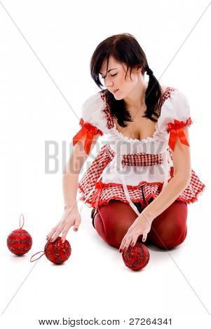 Attractive woman holding christmas red ball on white background