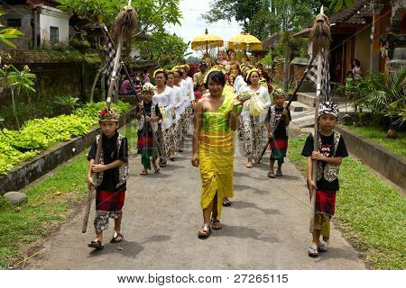 BALI, INDONESIA - NOV 24: Traditional wedding ceremony on November 24, 2010 in Bali, Indonesia. The ceremony takes place in old royal palace and all vilagers participate in the ceremony