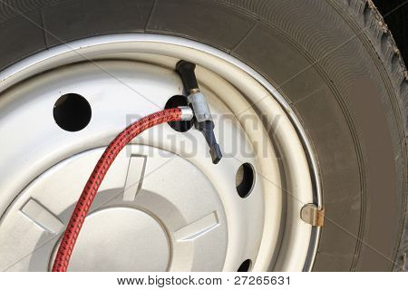 Hose of the pump puted on the wheel