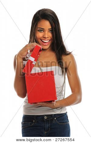 Beautiful African American woman opening red gift box isolated over white background