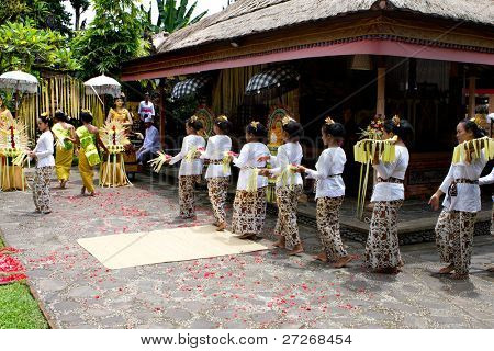 BALI, INDONESIA - NOV 24: Traditional wedding ceremony on November 24, 2010 in Bali, Indonesia. The ceremony takes place in old royal palace and all villagers participate in the ceremony