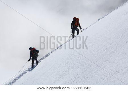 Alpinists climbing Mont Blanc