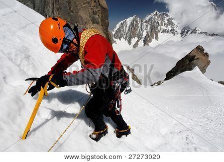 Climbing alpinist on Dent du Geant, France