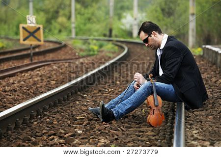 Young man waiting for the train