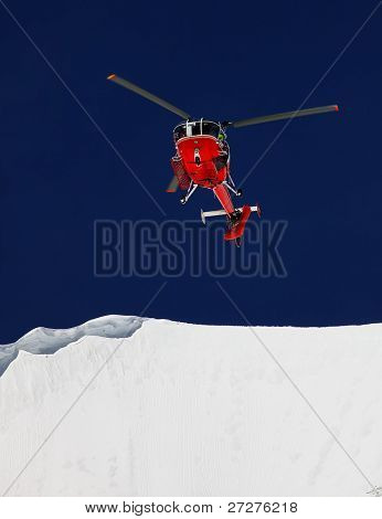 Mountain Rescue Helicopter recuperating a body from a crevasse
