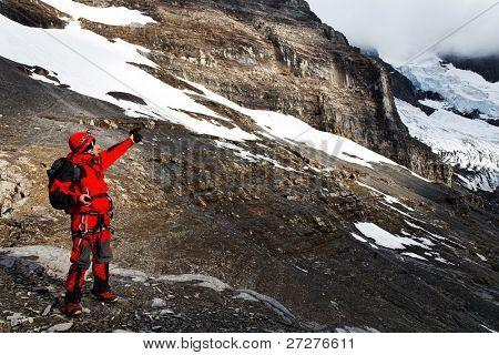 Alpinist pointing a route on Eiger Glacier, Berner Oberland, Switzerland - UNESCO Heritage