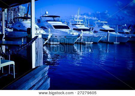 large yachts in the marina at night