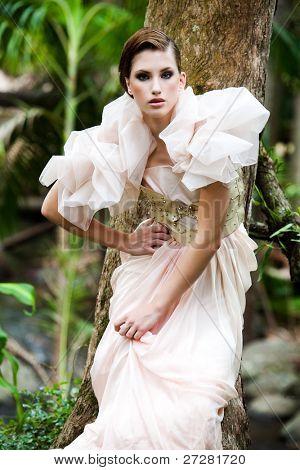 portrait of a beautiful fashion model wearing an elegant dress
