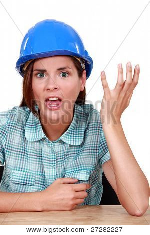 Woman with helmet doing grimace