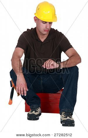 A janitor staring at his watch.