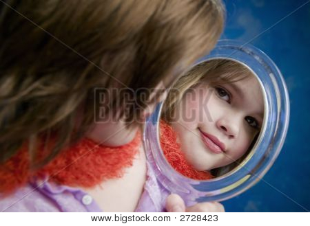 Little Girl Looking A Mirror