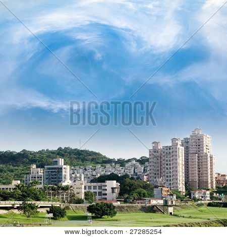 Here is a cityscape of apartment with blue sky.
