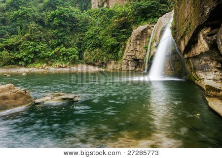 Jungle and waterfall with river in the wild.
