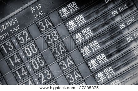 """Railroad timetable wrote """" On Time"""" in Taipei."""