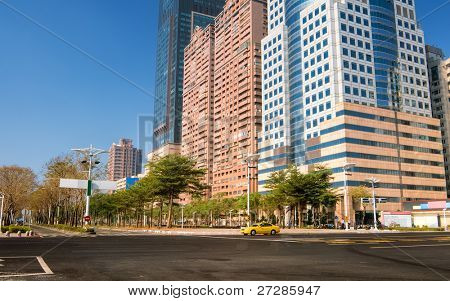 City street scenery with empty road and beautiful buildings in Kaohsiung, Taiwan.