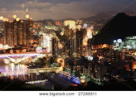 Color city night with focus blurred shape in Taipei, Taiwan.