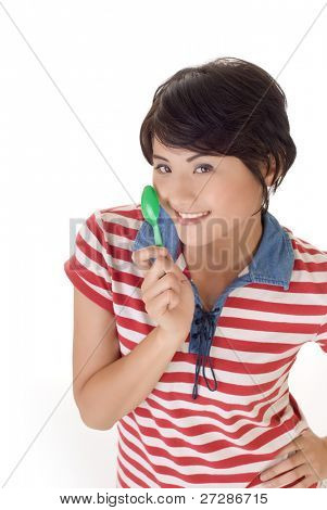 Happy eating time, closeup portrait of girl holding tablespoon and smiling on white background.