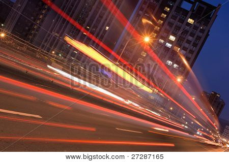 City night scene with car motion blurred in Taipei, Taiwan, Asia.