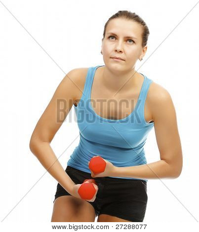 Power fitness. Girl with barbells on white background