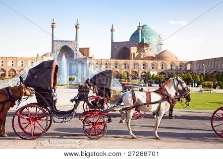 Carriage with horses on Naqsh-i Jahan Square on sunny day, Isfahan, Iran