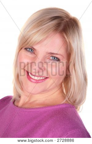 Middleaged Woman In Pink Shirt Face Close-Up