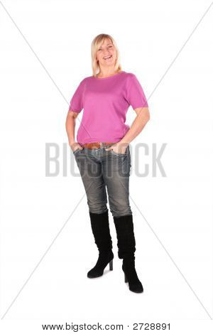 Middleaged Woman In Pink Shirt Stands