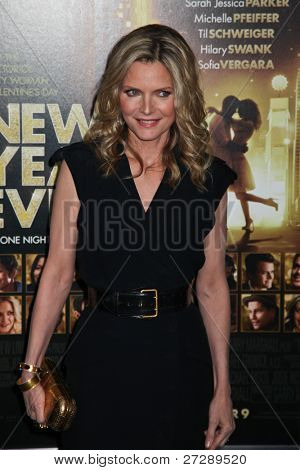 NEW YORK, NY - DECEMBER 07: Actress Michelle Pfeiffer poses for a photo during the 'New Year's Eve' premiere at Ziegfeld Theatre on December 7, 2011 in New York City.