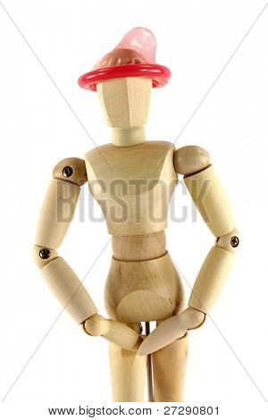 A wooden mannequin with condom on his head, conceptual photo of thinking with the right head