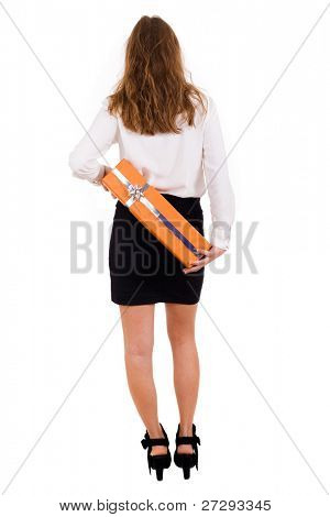 Elegant business woman hiden a gift on her back, isolated on white