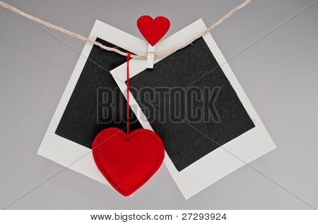 instant photo frame hanging on the clothesline. Isolated on white background.
