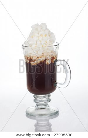 Mug of Irish Coffee with green sprinkles and clover leaf for St Patrick's Day