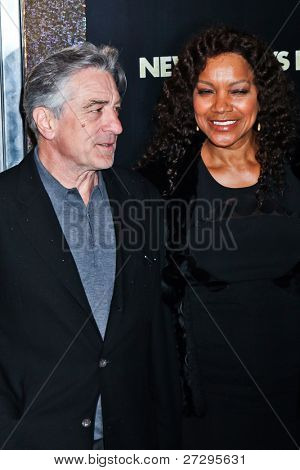 NEW YORK  - DECEMBER 07: Actor Robert De Niro and Grace Hightower poses for a photo during the 'New Year's Eve' premiere at Ziegfeld Theatre on December 7, 2011 in New York City.