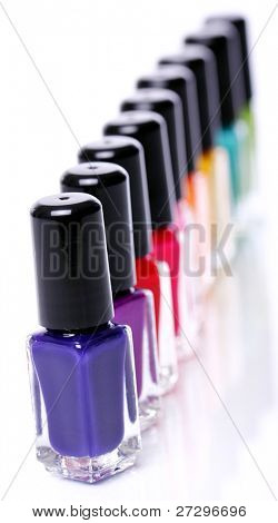 Colorful nail polish over white background