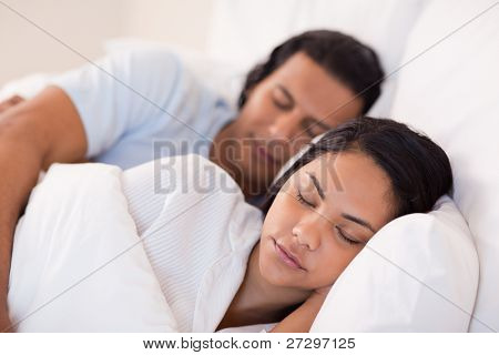 Side view of young couple being asleep