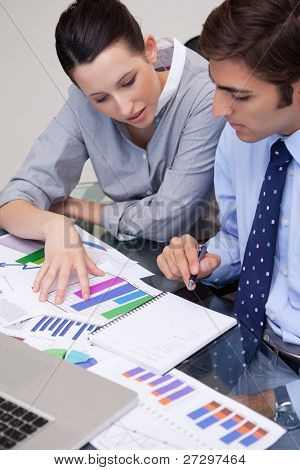 Young business team analyzing charts