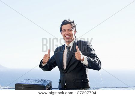 Businessman with the thumbs up in a swimming pool