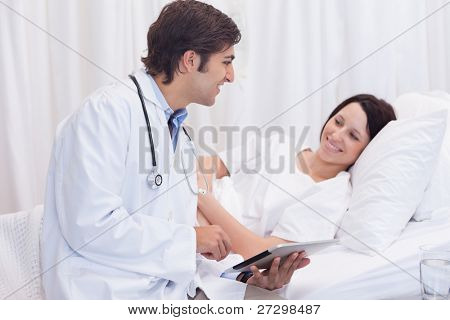 Young doctor telling his patient the good news