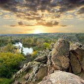 stock photo of landscapes beautiful  - Landscape with rock in forest at sunset - JPG