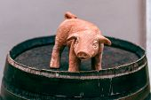 Сeramic Toy Pig On A Wine Barrel. Chinese Horoscope Year Of The Pig. 2019 New Year Of Pig. Chinese N poster