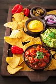 mexican nachos tortilla chips with guacamole, salsa and cheese dip poster