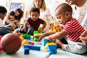 Diverse children enjoying playing with toys poster