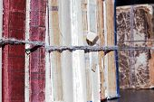 Close-up Old Books Tied With A Rope On Wooden Shelf  In The Library Or In The Archive poster