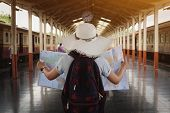 Young Woman Traveler Holding Map Standing On Platform At Train Station For Travel. Travel Concept By poster