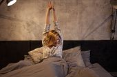 Girl The Morning Stretching In Bed. Early Morning, The Sun Had Not Risen Yet poster