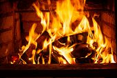Burning Firewood In The Fireplace In The House, Giving Heat And Heat. The Concept Of Heating In The  poster