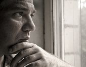 picture of sad man  - Sad man looking out the window - JPG